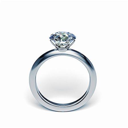 diamond - Silver diamond ring upright on white surface Stock Photo - Premium Royalty-Free, Code: 613-07673746