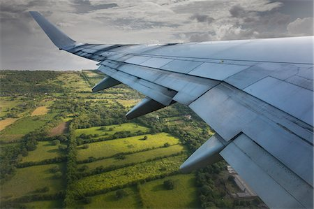 View of Airplane Wing and Nicaragua Below Stock Photo - Premium Royalty-Free, Code: 613-07673740
