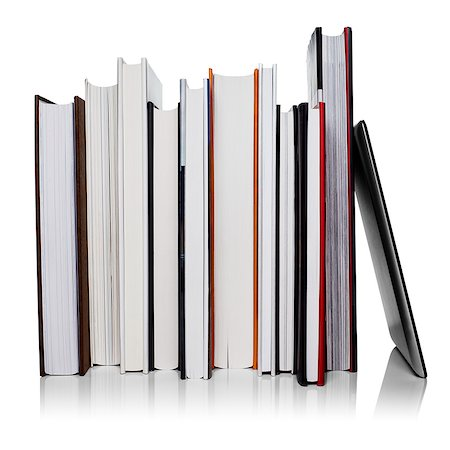 Row of books leaning against a tablet computer Stock Photo - Premium Royalty-Free, Code: 613-07734527
