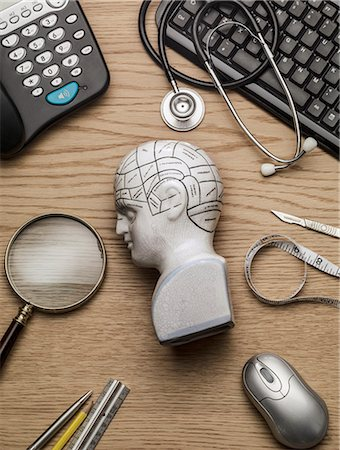 Phrenology Head on a doctors head side on Stock Photo - Premium Royalty-Free, Code: 613-07734554