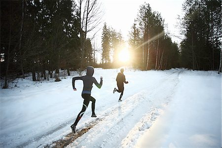 Two runners on snowy forest road in the morning Stock Photo - Premium Royalty-Free, Code: 613-07734580