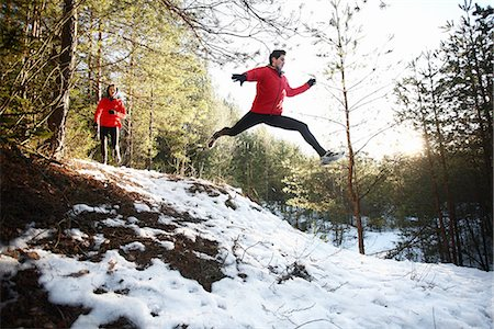 Two runners on forest road in winter Stock Photo - Premium Royalty-Free, Code: 613-07734583
