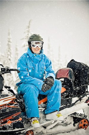 Man on snowmobile Stock Photo - Premium Royalty-Free, Code: 613-07734663