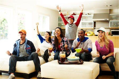 Friends watching baseball and cheering. Stock Photo - Premium Royalty-Free, Code: 613-07767490