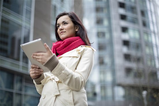 A woman using a digital tablet. Stock Photo - Premium Royalty-Free, Image code: 613-07767682