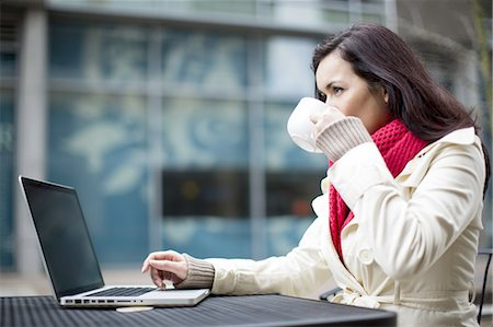 A woman using a laptop computer. Stock Photo - Premium Royalty-Free, Code: 613-07767683
