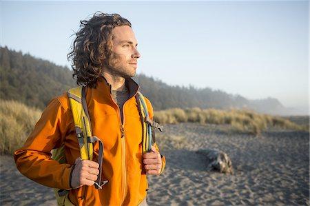 Man hiking near the ocean. Stock Photo - Premium Royalty-Free, Code: 613-07767856