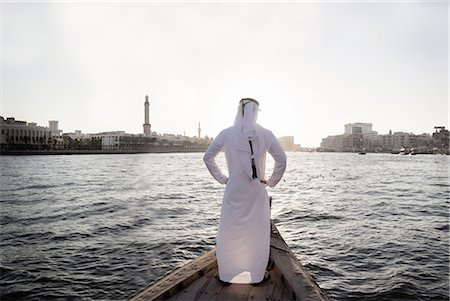 Arab businessman in traditional dress, Dubai Creek Stock Photo - Premium Royalty-Free, Code: 613-07780214