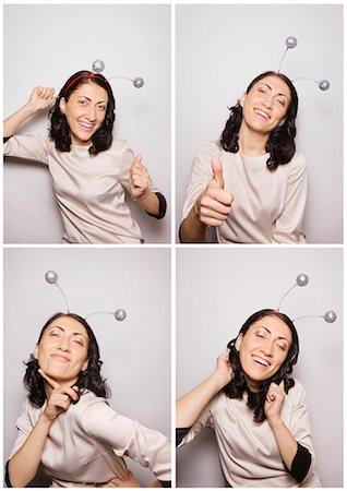 Woman in photo booth wearing party boppers Stock Photo - Premium Royalty-Free, Code: 613-07780313