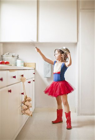 superhero - Kitchen warrior Stock Photo - Premium Royalty-Free, Code: 613-07780408