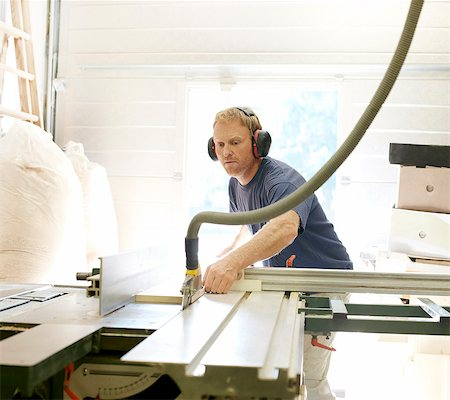 Man working in woodshop Stock Photo - Premium Royalty-Free, Code: 613-07780723