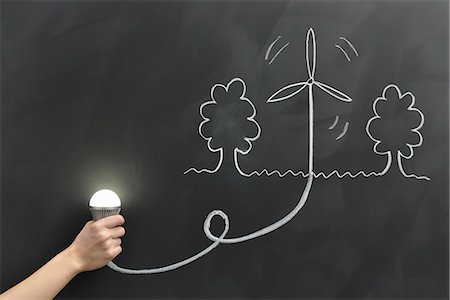 draw black women - Hand holding the bulb, wind power is drawn on the Stock Photo - Premium Royalty-Free, Code: 613-07780837