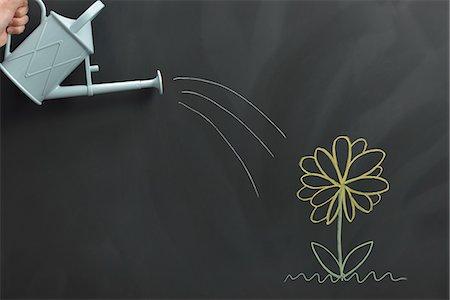 draw black women - Flower drawn on the blackboard Stock Photo - Premium Royalty-Free, Code: 613-07780844