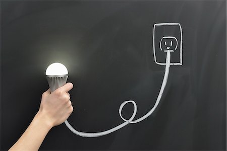 draw black women - Hand holding a light bulb and the outlet Stock Photo - Premium Royalty-Free, Code: 613-07780850