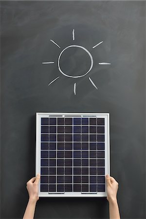 draw black women - Sun drawing on the blackboard with solar panel Stock Photo - Premium Royalty-Free, Code: 613-07780861