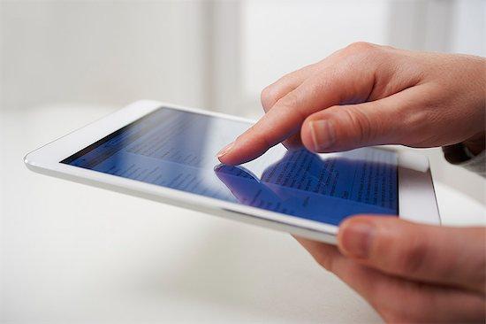 Touchscreen tech Stock Photo - Premium Royalty-Free, Image code: 613-07780972