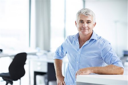 Proud businessman in his office Stock Photo - Premium Royalty-Free, Code: 613-07845102