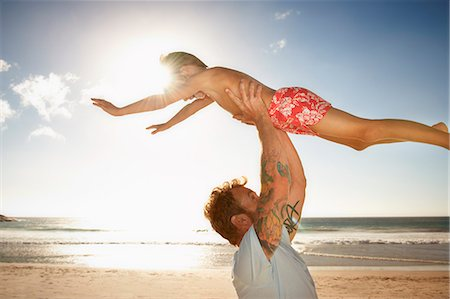 Father and son (6 - 8 years) playing on beach Stock Photo - Premium Royalty-Free, Code: 613-07845138