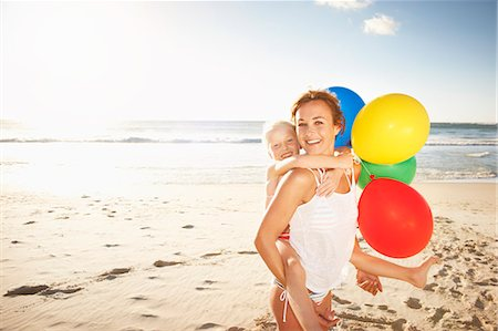 Portrait of mother and daughter on beach Stock Photo - Premium Royalty-Free, Code: 613-07845144