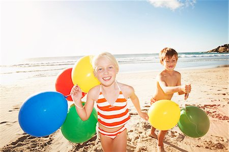 Children (6 - 8 years) playing on beach Stock Photo - Premium Royalty-Free, Code: 613-07845142