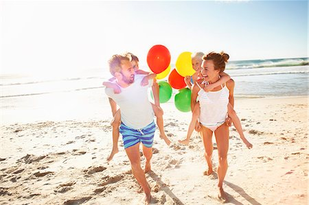 families playing on the beach - Family playing on beach Stock Photo - Premium Royalty-Free, Code: 613-07845143