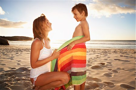 Mother on beach, wrapping son in towel Stock Photo - Premium Royalty-Free, Code: 613-07845151
