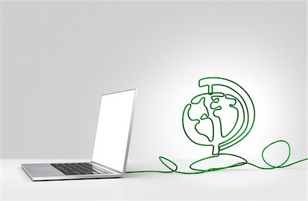 Laptop computer with cable forming a globe Stock Photo - Premium Royalty-Free, Code: 613-07845186