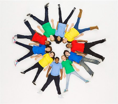 Group of children laying in circle formation Stock Photo - Premium Royalty-Free, Code: 613-07848677