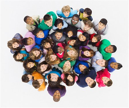 Aerial view of group of smiling children Stock Photo - Premium Royalty-Free, Code: 613-07848697