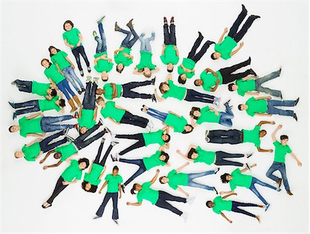 Aerial view of group of children laying on floor Stock Photo - Premium Royalty-Free, Code: 613-07848692