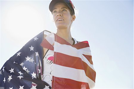 Female athlete wrapped in American flag Stock Photo - Premium Royalty-Free, Code: 613-07848815