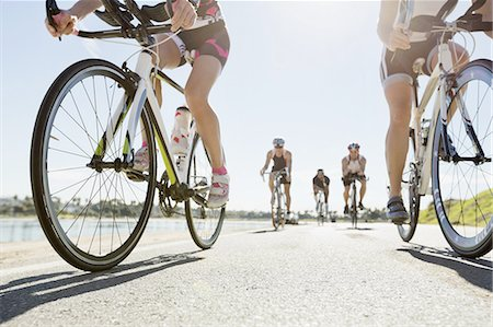 five people - Triathlon cyclists racing on street Stock Photo - Premium Royalty-Free, Code: 613-07848972