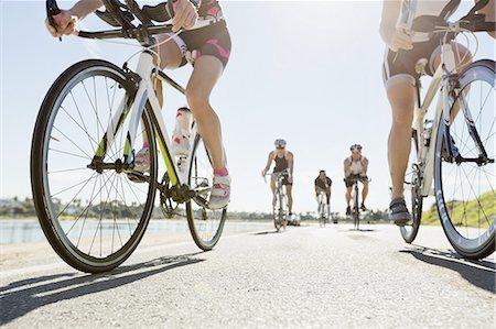 five people - Triathlon cyclists racing on street Stock Photo - Premium Royalty-Free, Code: 613-07848972