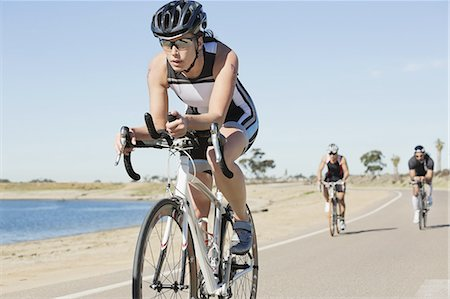 dark glasses - Triathletes cycling on street Stock Photo - Premium Royalty-Free, Code: 613-07848988