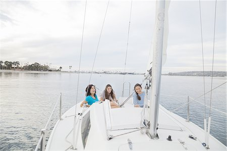 Mother and daughters having fun on sailboat Stock Photo - Premium Royalty-Free, Code: 613-07849035