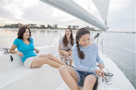Mother and teenage daughters sailing on lake Stock Photo - Premium Royalty-Free, Code: 613-07849031