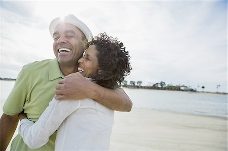 Loving mature couple embracing on beach Stock Photo - Premium Royalty-Free, Code: 613-07849117
