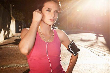 Female runner preparing in urban environment Stock Photo - Premium Royalty-Free, Code: 613-07849232