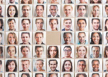 Grid of portrait prints, one missing in centre Stock Photo - Premium Royalty-Free, Code: 613-07849419