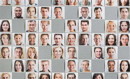 Grid of portrait prints, some gaps, random pattern Stock Photo - Premium Royalty-Free, Code: 613-07849420