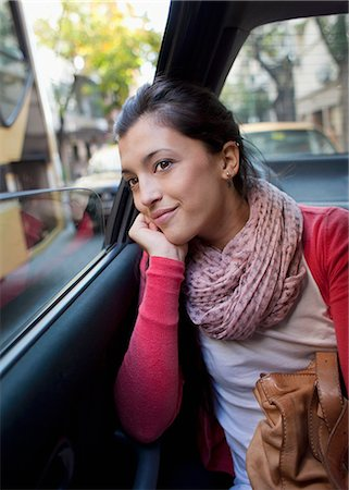 people in argentina - woman in the back of a car, looking out the window Stock Photo - Premium Royalty-Free, Code: 613-08057009