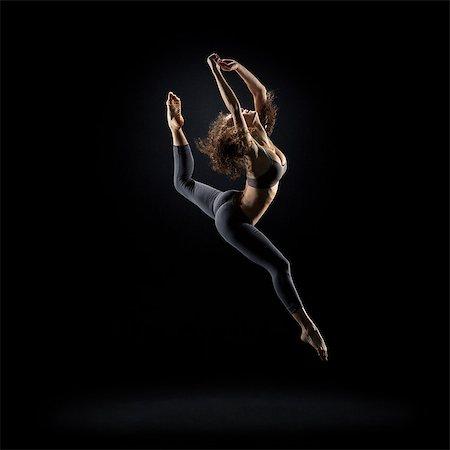 Dancer pose on black background Stock Photo - Premium Royalty-Free, Code: 613-08057146