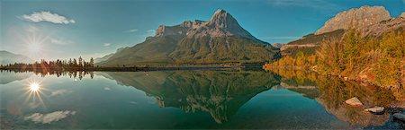 scenic view - Sun rises above mountain lake, autumn Stock Photo - Premium Royalty-Free, Code: 613-08057368