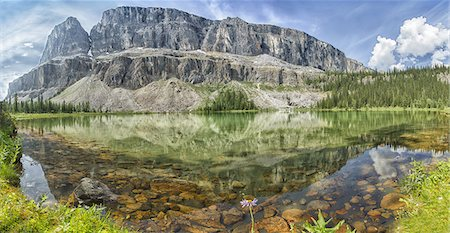 Refelction and rock shallows of mountain pond Stock Photo - Premium Royalty-Free, Code: 613-08057370