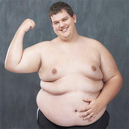 fat man exercising - Flaunting his flab! Stock Photo - Premium Royalty-Free, Code: 613-08057663