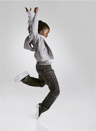 preteen dancing - Working on his hip hop routine Stock Photo - Premium Royalty-Free, Code: 613-08180846