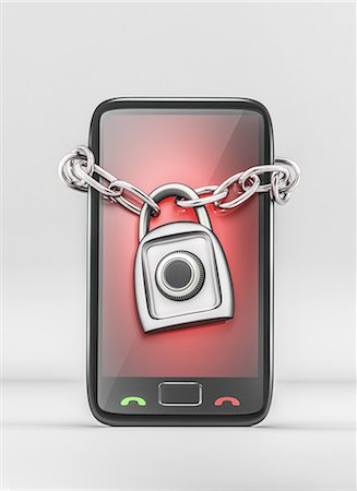 Mobile phone wrapped with lock Stock Photo - Premium Royalty-Free, Code: 613-08180914