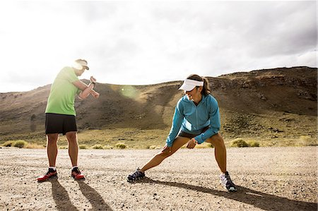 Couple stretching while running Stock Photo - Premium Royalty-Free, Code: 613-08201440
