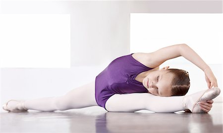 preteen girls stretching - Limbering up before the recital Stock Photo - Premium Royalty-Free, Code: 613-08234140