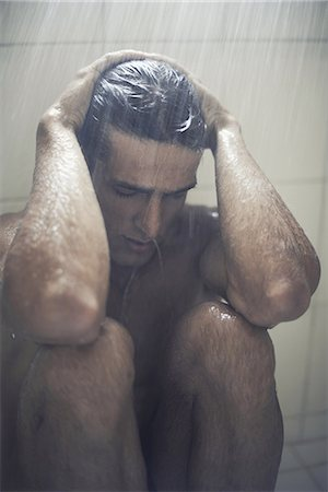 shirtless men - Depression is getting him down Stock Photo - Premium Royalty-Free, Code: 613-08235026